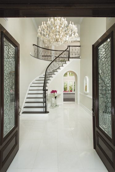 Marble flooring and a new chandelier welcome guests into the foyer.