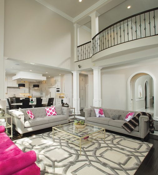 The two-story family room flows into the open-plan kitchen.