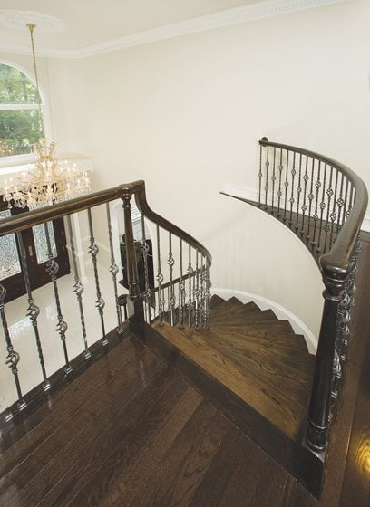 Wrought-iron pickets replaced the original wooden ones on the stairway.