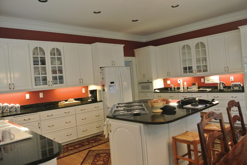 BEFORE: The previous kitchen had a dated, traditional vibe.