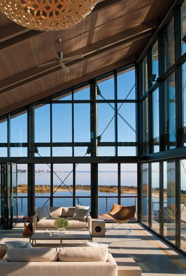 The living and entertaining pavilion is enclosed by impact-resistant, insulated glass rising to a fir-trimmed ceiling.