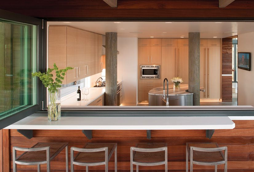 A bar with a fold-away window separates the kitchen from the porch.