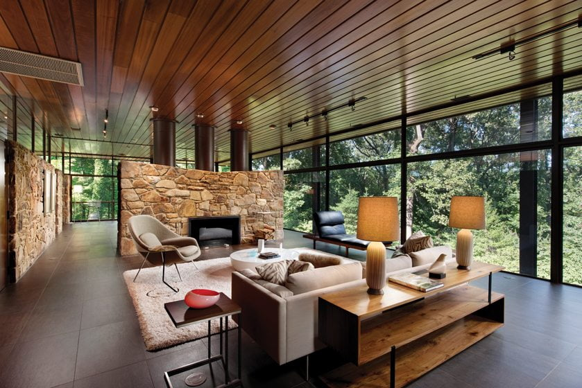 Stone half-walls delineate the spaces, ensuring maximum views and abundant natural light.