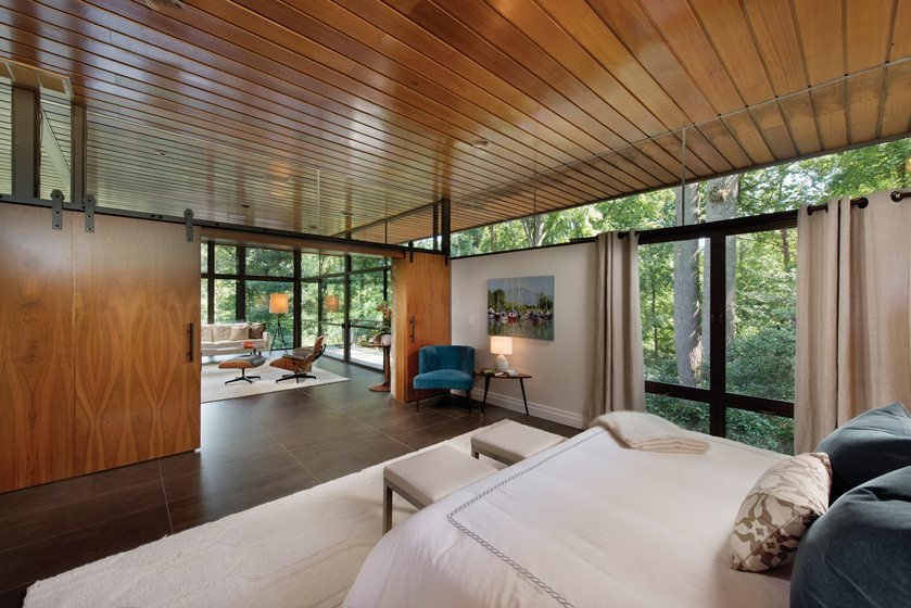 Sliding doors connect the master bedroom to the airy living spaces.