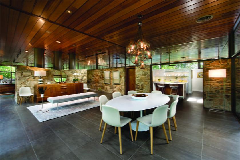 "An Arteriors ""Caviar"" chandelier hangs over a Saarinen dining table."