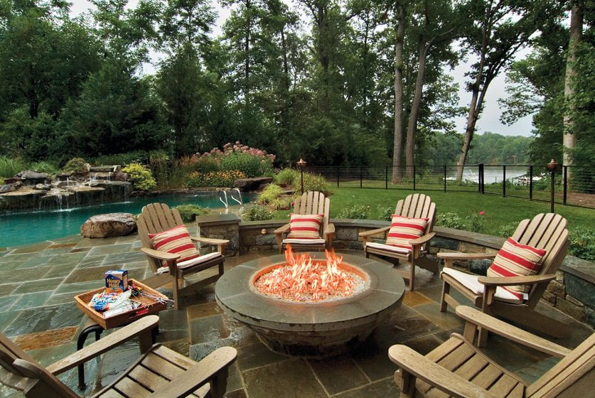 The pool and adjacent fire pit are unified by a flagstone patio.