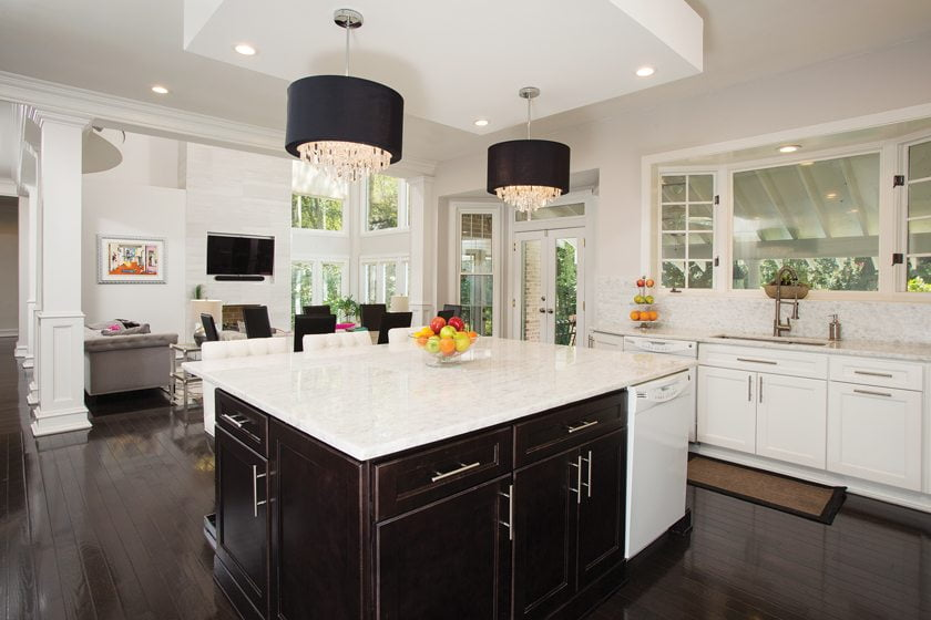 The dated kitchen has been transformed with Signature Vintage cabinetry and quartzite countertops.