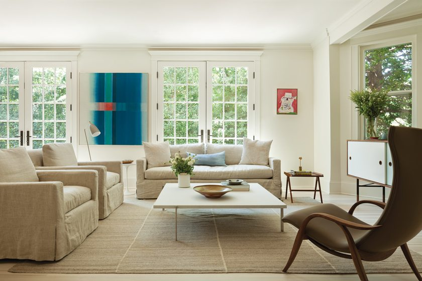 In the great room, a large abstract by Leon Berkowitz is flanked by French doors.