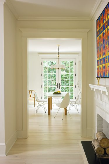 A geometric abstraction by Karl Benjamin presides over the fireplace mantel.