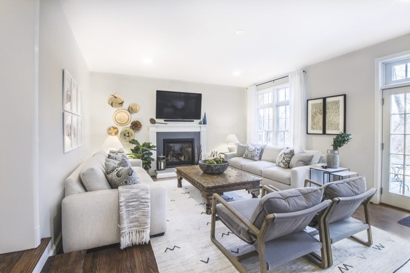 The family room combines chairs from Four Hands, Robin Bruce sofas and a rug from Surya.