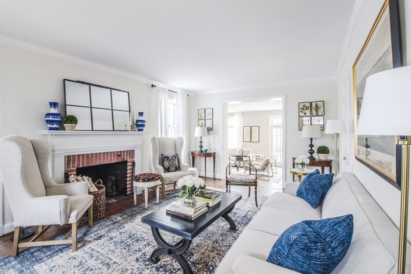 A Loloi rug in blue and cream anchors the living room, where Risdon repurposed the owners' existing furniture.