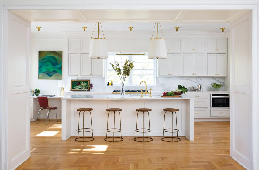 The enlarged and remodeled kitchen centers on a marble-topped island with pendants from Circa Lighting.
