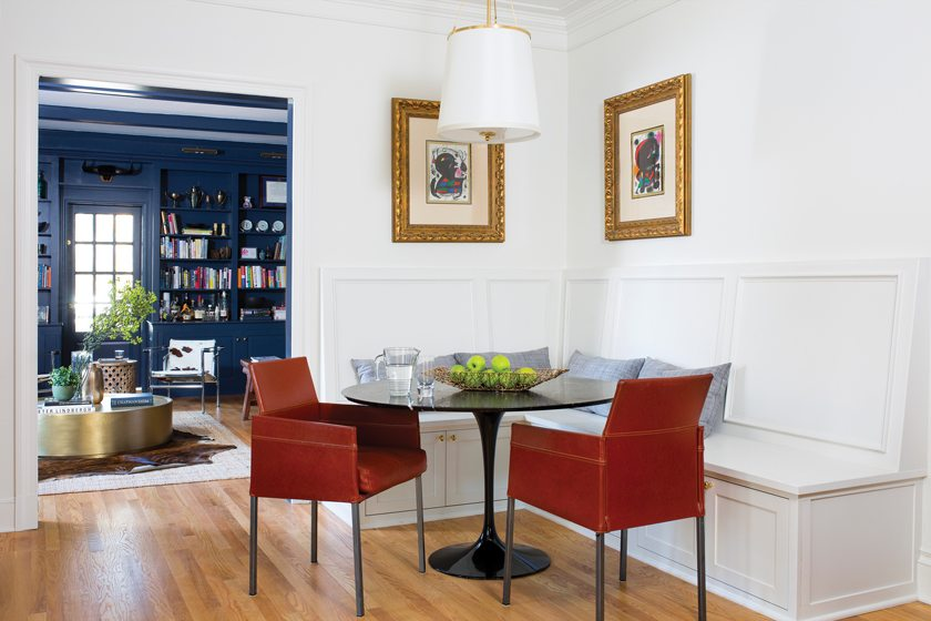 In the informal dining area, the table was designed by Saarinen and the chairs are from Design Within Reach.