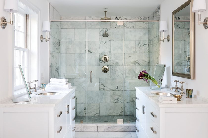 By relinquishing a former sewing room, Greer enlarged the master bath.