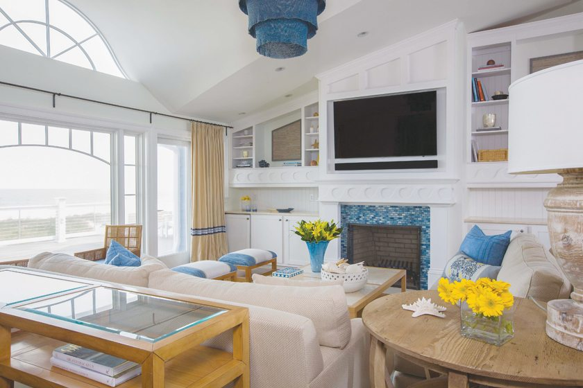 A wave motif embellishes millwork in the living area, where sofas are paired with a coffee table by David Edward.