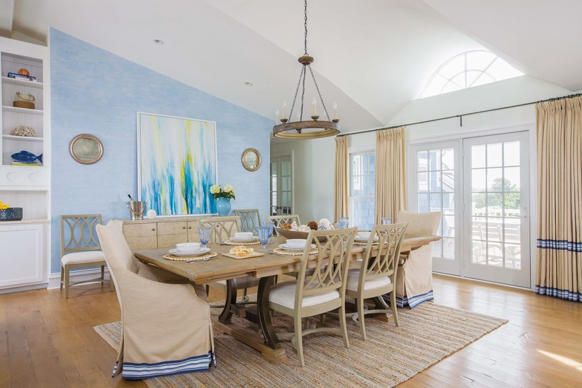 The Stanley dining room table and chairs, with host chairs by Vanguard, are elegant but durable.