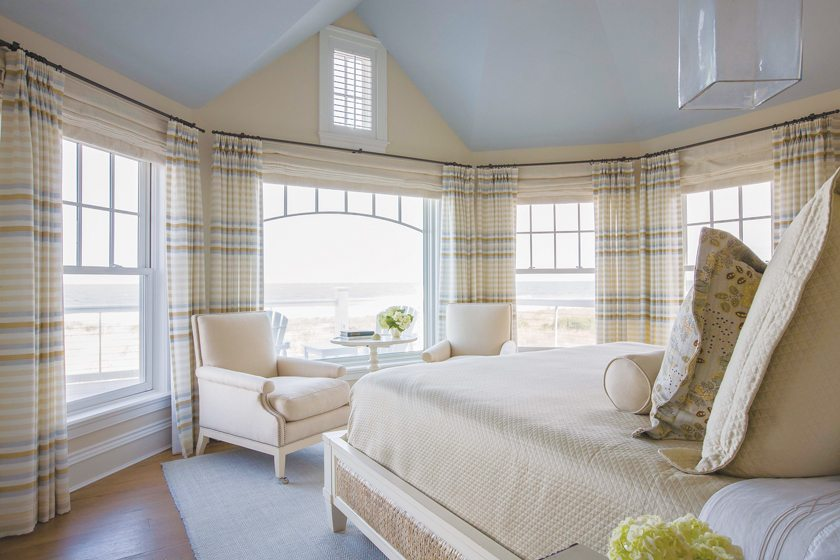 The master bedroom, perched on the upper floor, affords panoramic ocean views.