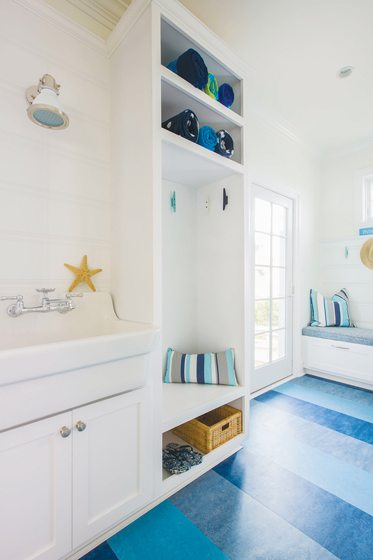 Forbo Marmoleum flooring in the adjacent mudroom sets the right tone for a day at the beach.