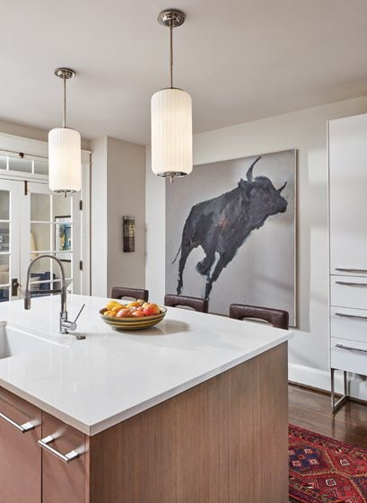 A painting of a bull by Katie Pumphrey occupies a place of honor in the kitchen.