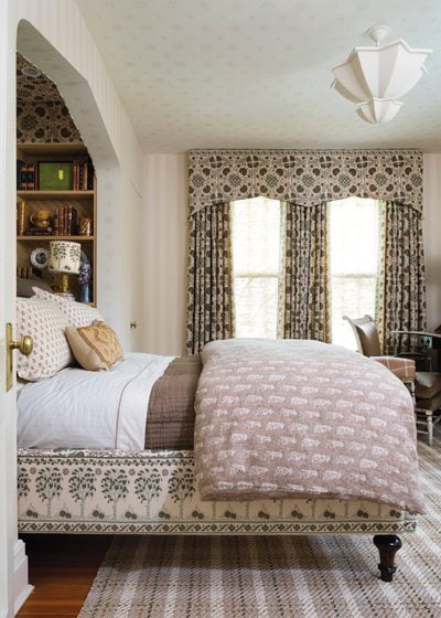 Fabric by Penny Morrison adorns the bed frame, alcove and draperies.