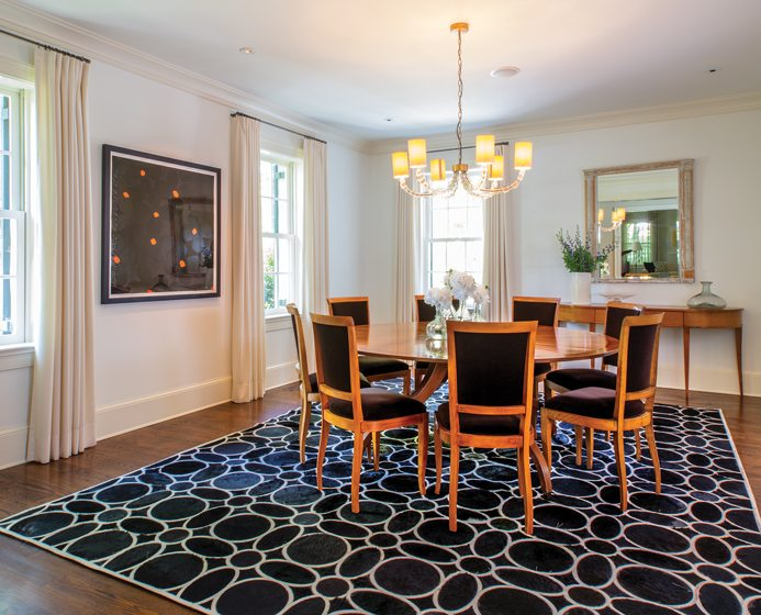 A Porta Romana chandelier hangs above a Rose Tarlow table in the dining room.