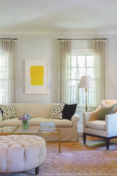 An Ellsworth Kelly painting presides over a custom sofa and antique Oushak rug from Timothy Paul.