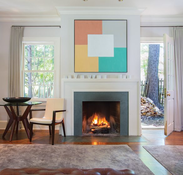 A Jacob Kainen painting adds punches of color to the largely neutral space.