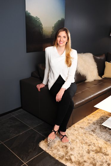 Katie DeStefano sits on BoConcept's Mezzo sofa. Photo © Michael Ventura.