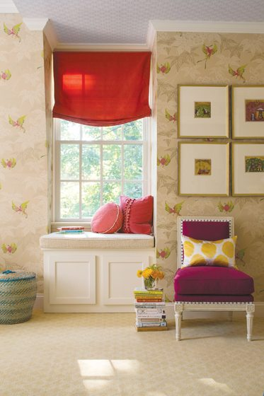 A girl's room focuses on details, from the Osborne & Little  wallpaper to the pillow with beaded trim.