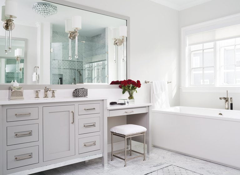 The marble-clad master bath is light and sophisticated.