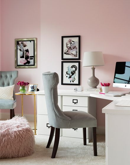 Pink walls envelop the wife's office, where art by Rachel Wishner lends a graphic element.