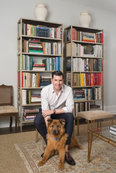 The designer's treasured book collection and his dog, Spencer, are sources of pleasure.