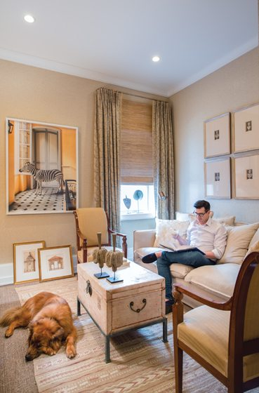 The sitting room/guest room features a William Curtis Rolf photograph of a stuffed zebra.