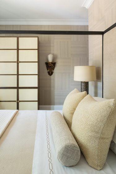 A copy of a piece by French furniture designer Jean Royère boasts a shoji-screen effect.