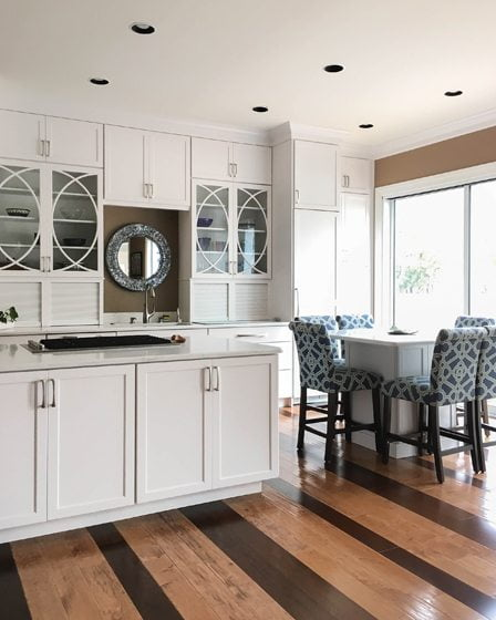Curved mullions on the Omega cabinets add a graceful touch in the kitchen.