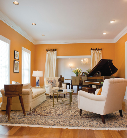 Saturated walls enliven the living room of a Winchester, Virginia, home designed by Miller.