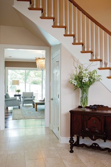 An antique chest anchors the foyer.
