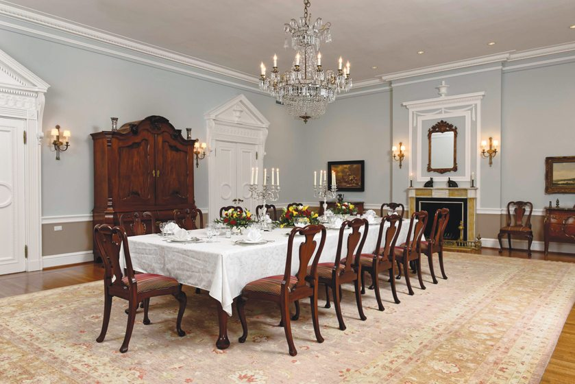 In the elegant dining room, a reproduction late-Baroque-style table boasts eight leaves.