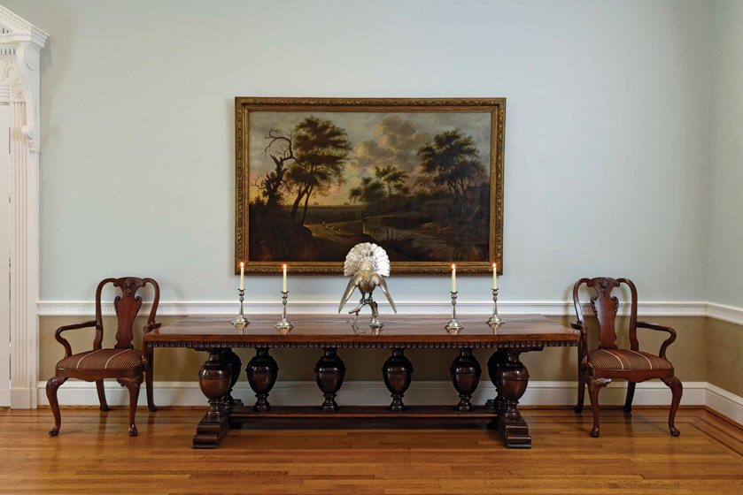 An oil painting by Flemish artist A.J. van der Croos hangs above a 17th-century refectory table.