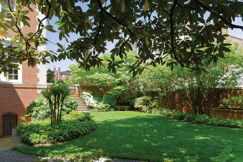 Beyond the patio, a courtyard garden is a favorite spot of the Ambassador and his family.
