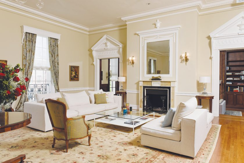 Modern seating mingles with traditional pieces in the main reception room.