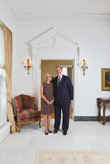 Ambassador Henne Schuwer and his wife, Lena Boman, pose in the second-floor hall.