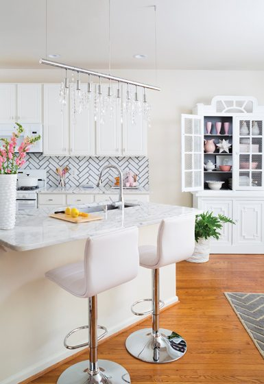 A stenciled backsplash in a chevron pattern brightens the kitchen.