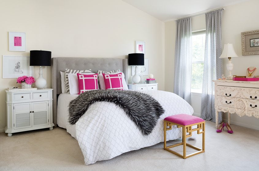 Magenta accents add a dose of whimsy to the master bedroom.