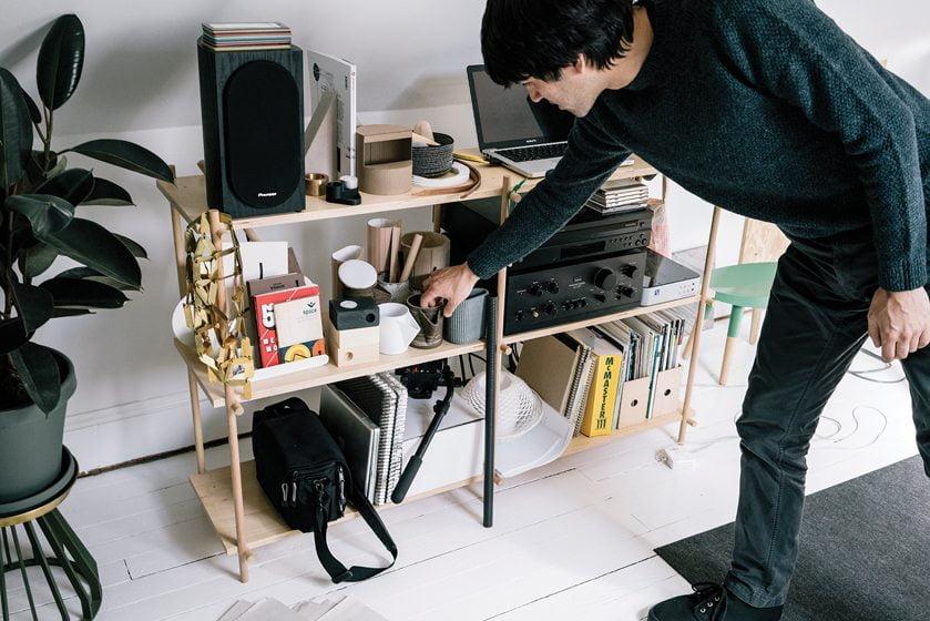 In Takagi's studio, shelves display some of his vessel and candleholder designs. © GREG KAHN