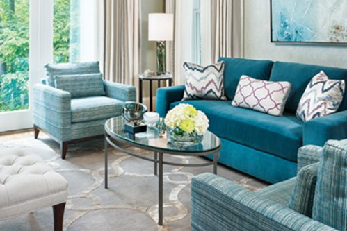 Susan Gulick, Susan Gulick Interiors, grounded an elegant living room with a wool-and-silk rug by Tibetano. © Judy Davis