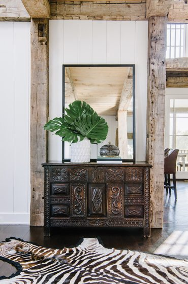 An antique carved-oak chest defines the open foyer.