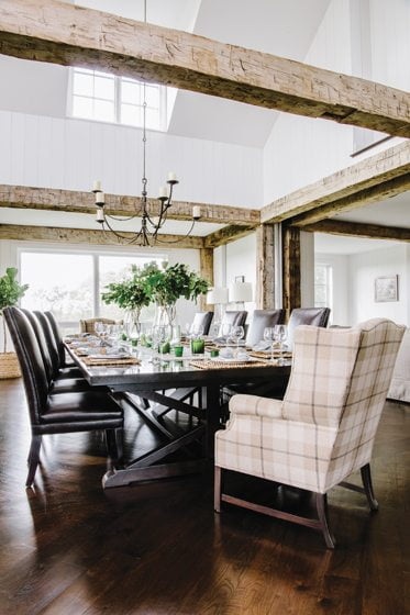 A Rose Tarlow chandelier hangs above the custom dining table.