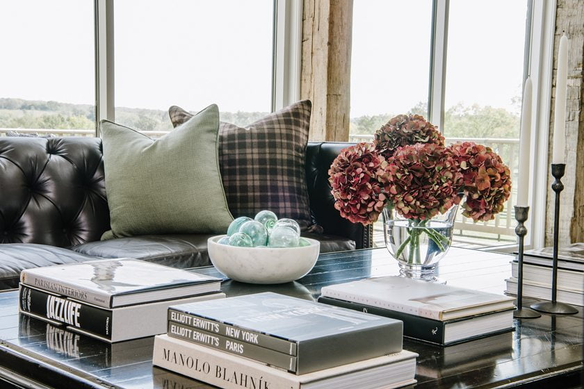Wool pillows warm up a Kravet sofa upholstered in Ralph Lauren leather.