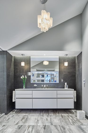 The floating vanity is by SieMatic.